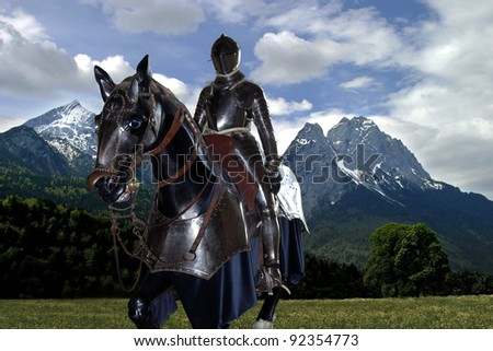 Knight riding in open field - stock photo