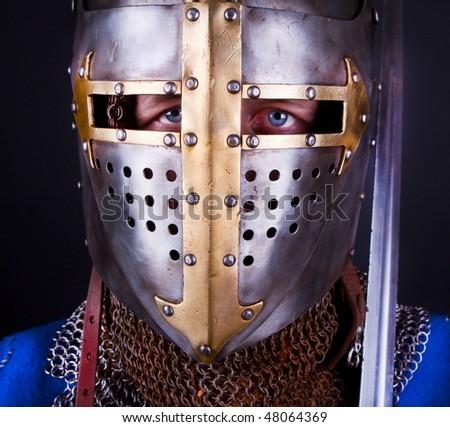 knight wearing  a helmet - stock photo