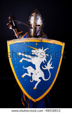 Knight with sword in combat position - stock photo