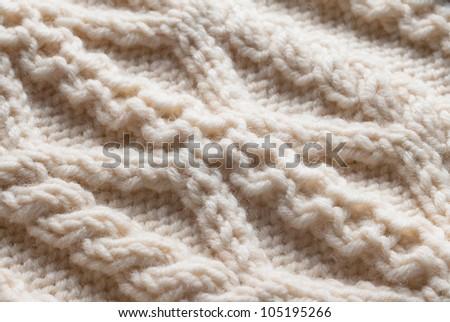 Knit woolen texture. Fabric beige background - stock photo