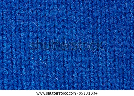 Knit woolen texture. Fabric blue background - stock photo