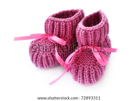 Knitted baby booties - stock photo