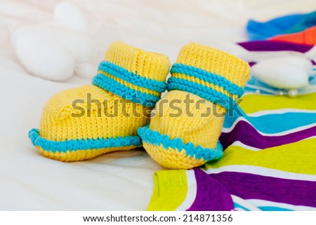 Knitted baby shoes - stock photo
