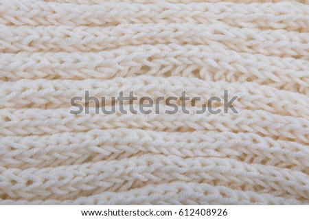 knitted canvas made of creamy knitwear. Close up