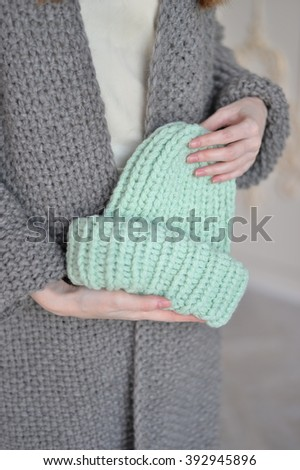 knitted cap in her hand - stock photo