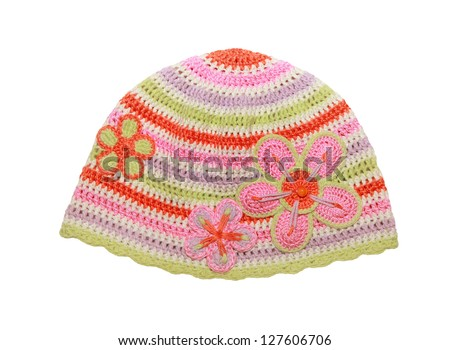 knitted cotton hat for little girl with flowers decorations - stock photo