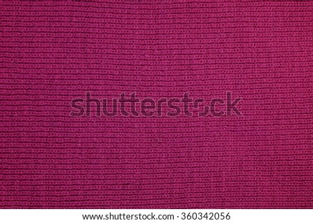 Knitted fabric knitted from wool purple. The texture of the background. - stock photo