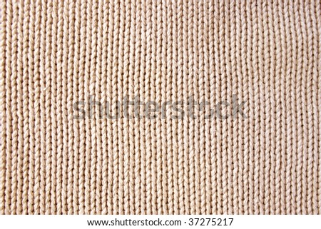 Knitted fabric - macro of a woolen texture - stock photo
