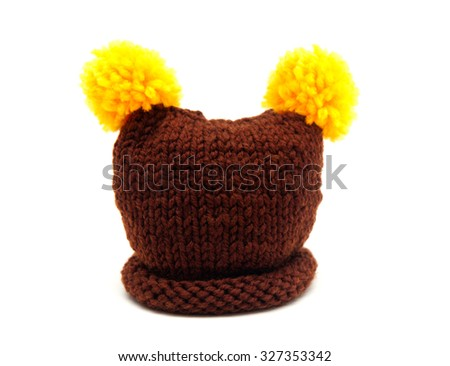 knitted hats for newborns isolated on white background - stock photo
