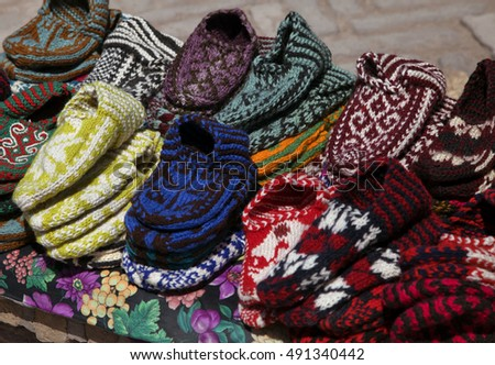 Knitted slippers in a street market, Uzbekistan