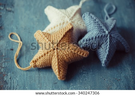 Knitted stars for Christmas tree - stock photo