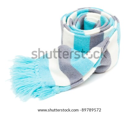 Knitted striped scarf with fringe isolated on the white background - stock photo