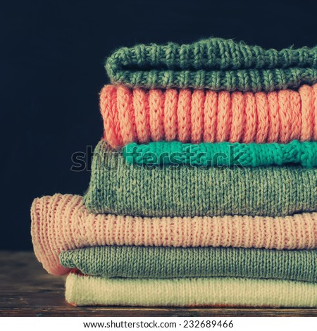 Knitted Sweet Color Sweaters in stack ,vintage style, toned square image - stock photo