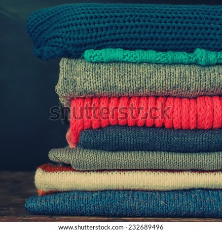 Knitted Sweet  Sweaters in stack ,vintage style, toned square image - stock photo