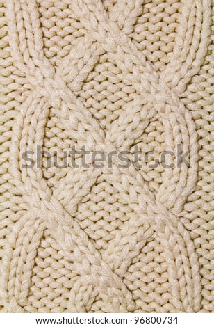 Knitted wool background with pattern - stock photo