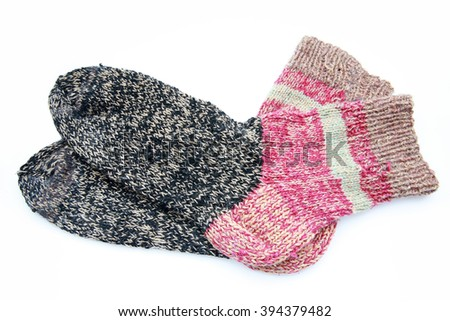 Knitted wool socks on a white background - stock photo