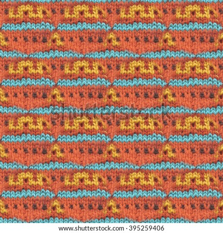 Knitted woolen seamless pattern. Beautiful red, blue, yellow knit texture for textile. Repeating abstract background.  - stock photo