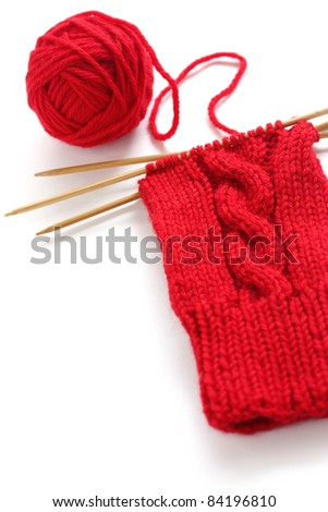 knitting image, a red yarn ball with noodles - stock photo