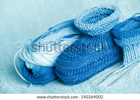 knitting of bootees for the newborn