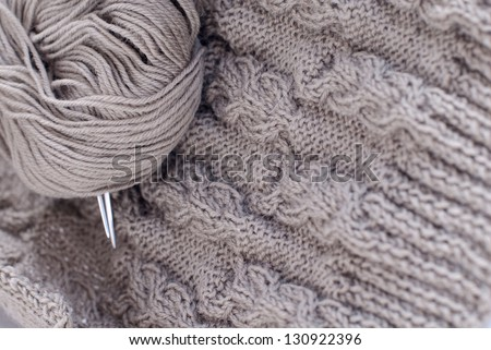 Knitting pattern and wool ball closeup details - stock photo