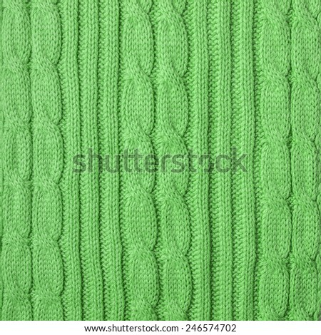 Knitting pattern from green  woolen warm soft yarn for background - stock photo