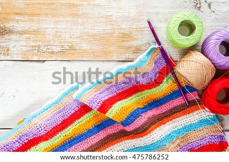 knitting project over wooden background, colorful summer knitting
