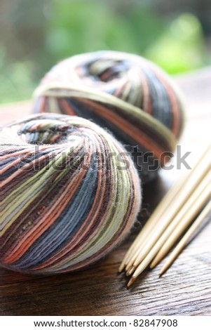 knitting sock yarn balls with noodles - stock photo