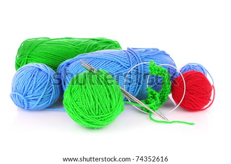 Knitting yarn and  knitting needles on white