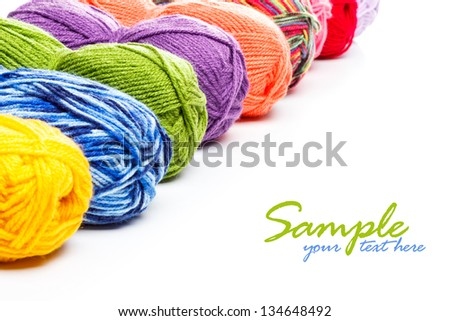 Knitting yarn arranged in row with space for your text - stock photo