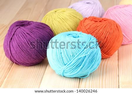 Knitting yarn on wooden background - stock photo