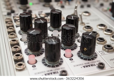 knobs on analog synthesizer   - music equipment closeup  - stock photo