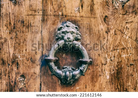 knocker on door to Bologna - stock photo