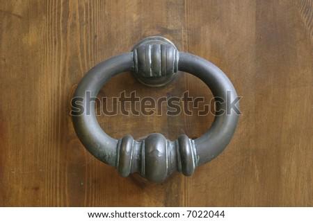 Knocker on wood door - stock photo