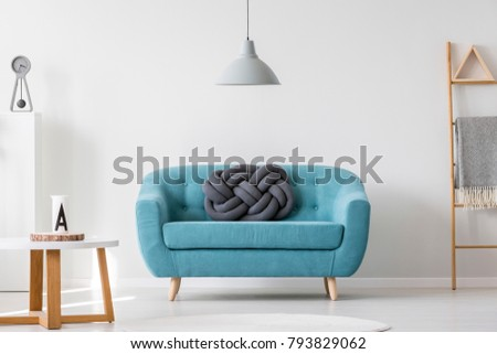 Knot Pillow On Turquoise Sofa In Living Room Interior With Gray Lamp,  Ladder And Wooden