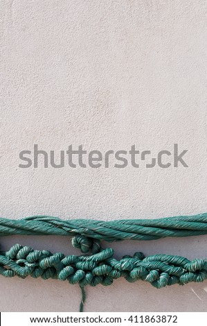 Knot rope around cement pole. - stock photo