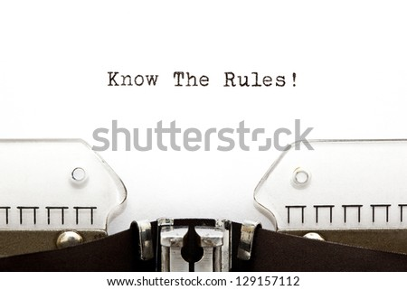 Know The Rules printed on an old typewriter. - stock photo