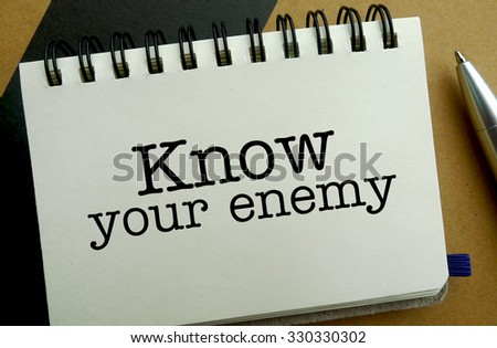 Know your enemy memo written on a notebook with pen - stock photo