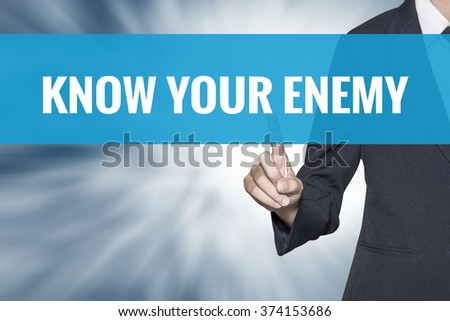 Know Your Enemy word on virtual screen touch by business woman cyan sky tab - stock photo