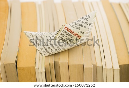 knowledge boat on books, business and training concepts - stock photo