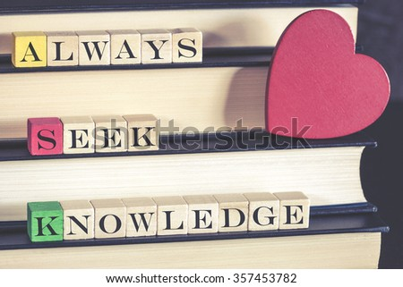 Knowledge concept with quote written on wooden blocks. Cross processed image with shallow depth of field - stock photo