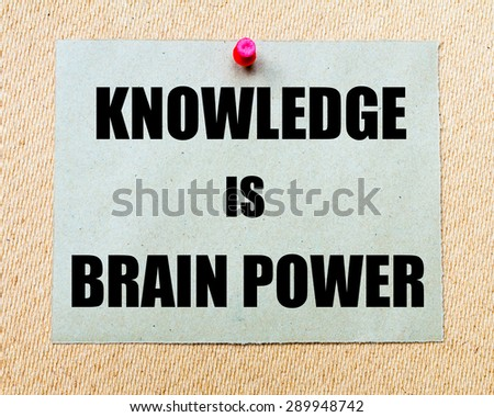Knowledge Is Brain Power written on paper note pinned with red thumbtack on wooden board. Motivation conceptual Image - stock photo