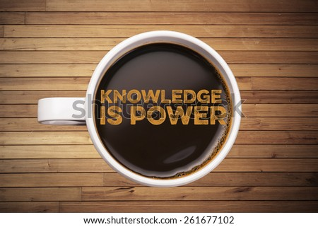 knowledge is power. coffee cup with wood background - stock photo