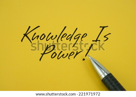 Knowledge Is Power! note with pen on yellow background