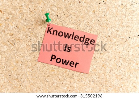 knowledge is power word typed on a paper and pinned to a cork notice board