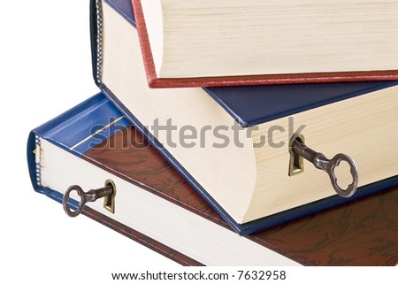 Knowledge is the key to success.  Three hardback books with keyholes and skeleton keys.  Conceptual image for unlocking the power within.  Isolated on white. - stock photo