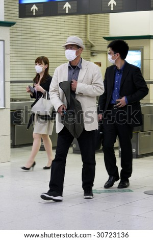 KOBE, JAPAN - MAY 20: People on the street wear face masks because of the outbreak of swine flu, Sannomiya JR station on May 20, 2009 in Kobe, Japan.