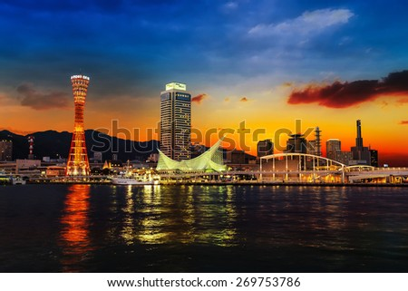 KOBE, JAPAN - OCTOBER 26:  Port of Kobe in Kobe, Japan on October 26, 2014. A Japanese maritime port in Kobe, Hyogo in the greater Osaka area, backgrounded by the Hanshin Industrial Region - stock photo