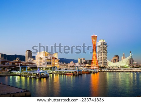 KOBE - OCT 24 :Kobe Port Tower and Maritime Museum were lighted up to on October 24, 2014 in Kobe, Japan. Port of Kobe is one of Japanese maritime port. - stock photo