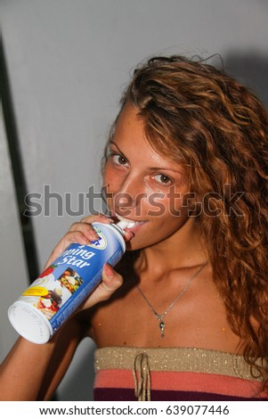 Koblevo, Ukraine July 20, 2011: People smiling and eat cream during concert in night club party.  woman has fun at club