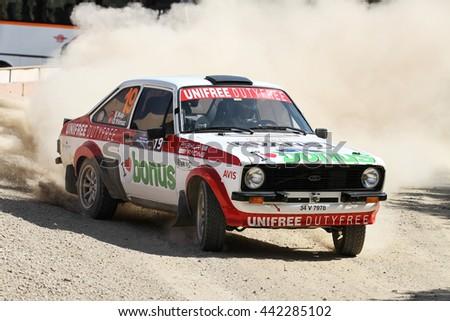 KOCAELI, TURKEY - JUNE 11, 2016: Engin Kap drives Ford Escort MK2 of Bonus Unifree Parkur Racing Team in Kocaeli Rally - stock photo